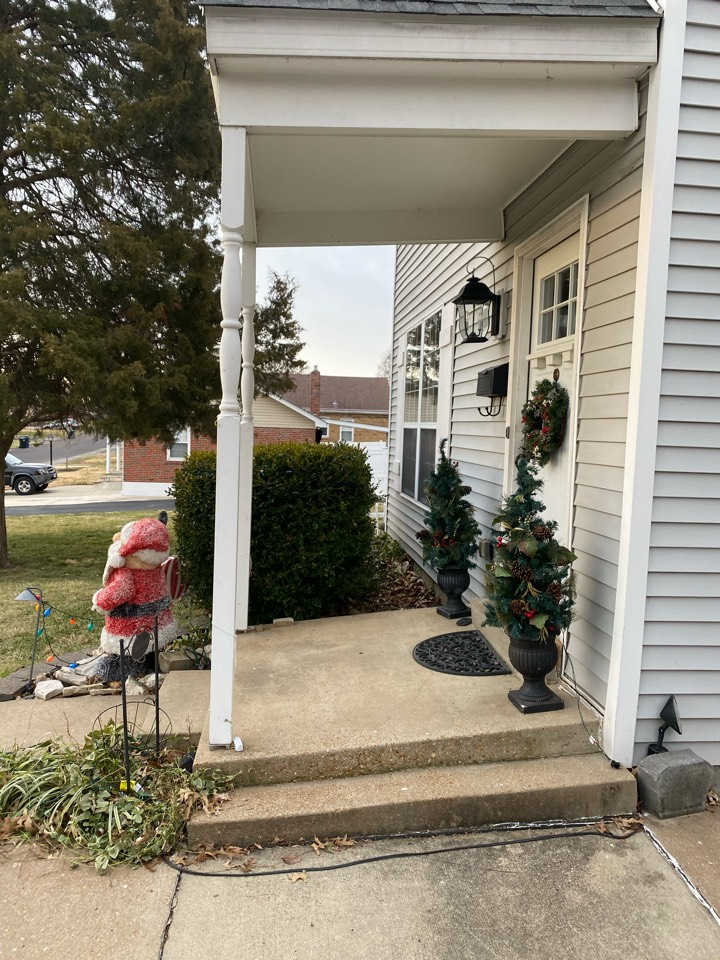 Affton, MO - Settling front porch. Piering and void fill are needed here.