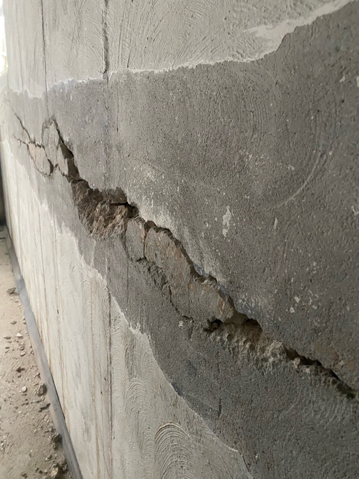 Florissant, MO - Foundation crack repair. Rebar pop discovered at this home. Today, we are repairing this.