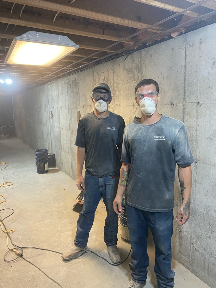 O'Fallon, MO - Tieback wall anchors for a bowing wall, being installed today. These guys work hard to repair your home!