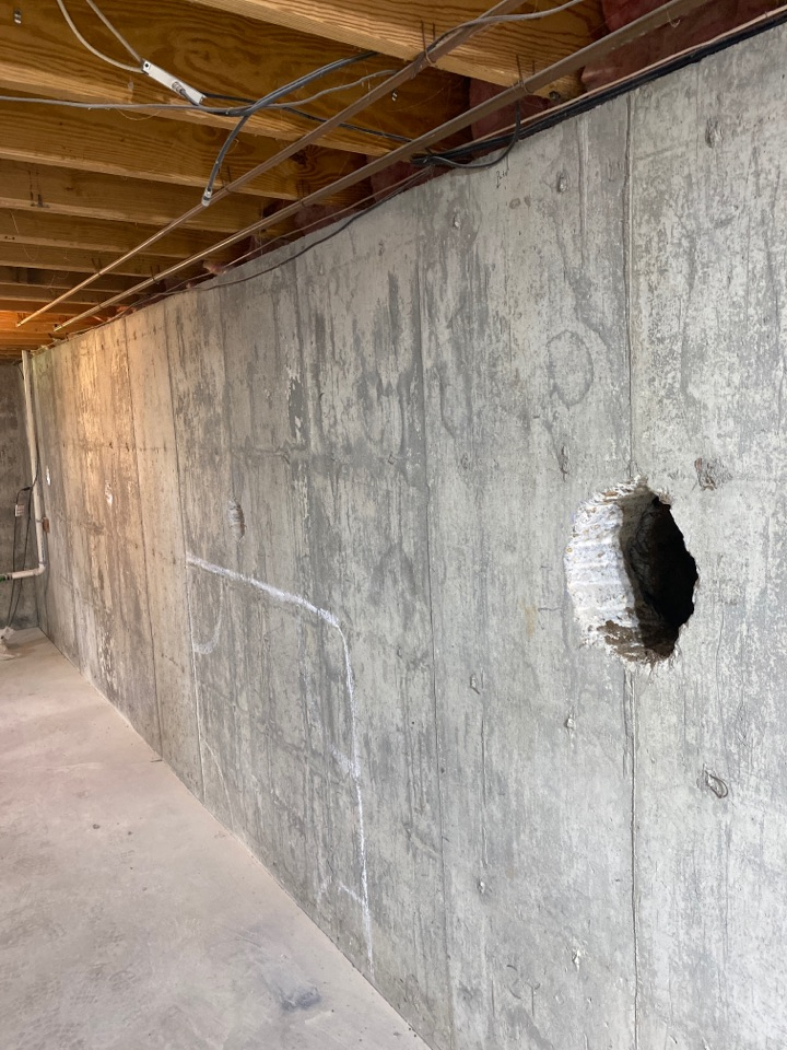 O'Fallon, MO - Wall anchor stabilization with crack injections on diagonal cracks.