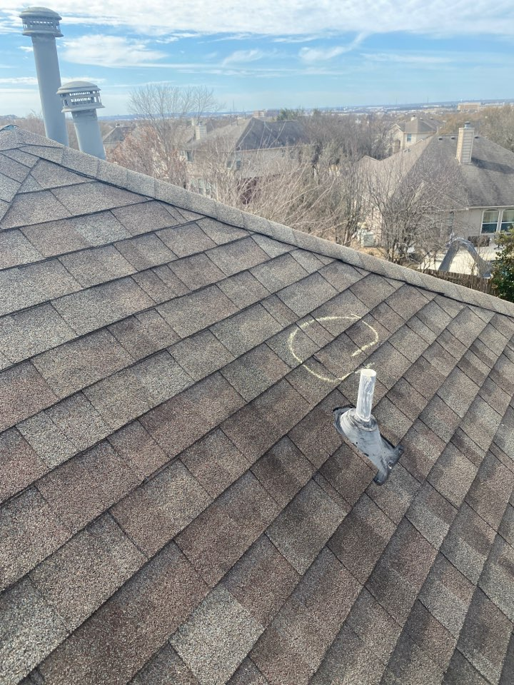 Round Rock, TX - Inspecting a roof for storm damage.
