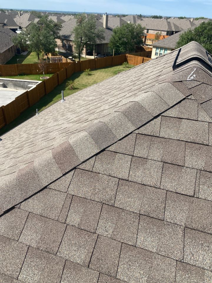 Round Rock, TX - Inspecting a hail damaged roof.