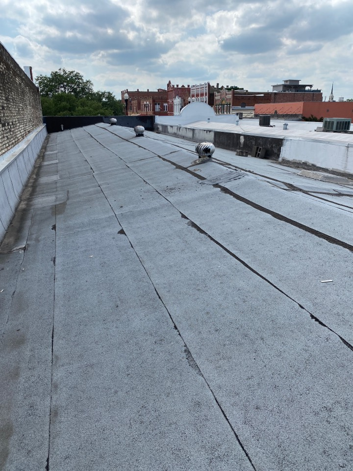 Lockhart, TX - Coaring is roof to bid a replacement with GAF TPO roof system. This building has 4 layers of roofing on it now. It has to be removed to the deck and start over.