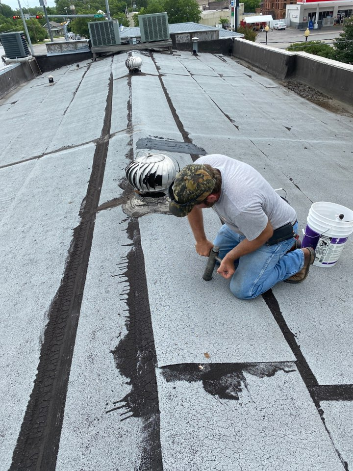 Lockhart, TX - Coring roof to prepare a proposal for replacement with GAF roof system with TPO