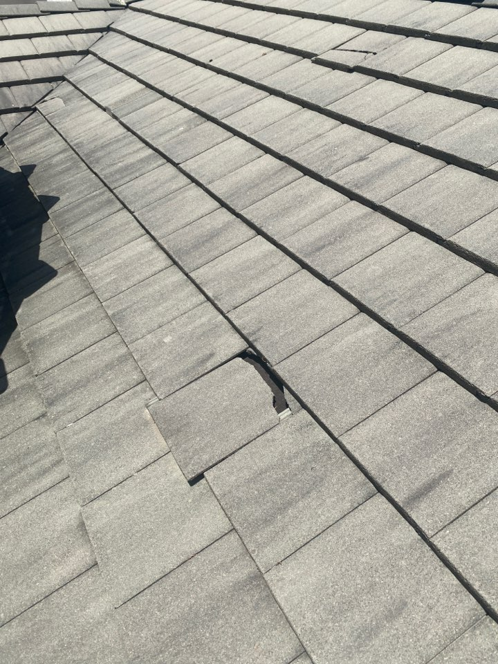Austin, TX - Inspecting gutters and finding additional roof damage