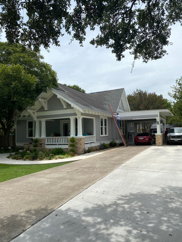 Lockhart, TX - Measuring the roof for replacement with a GAF lifetime warrantied roof