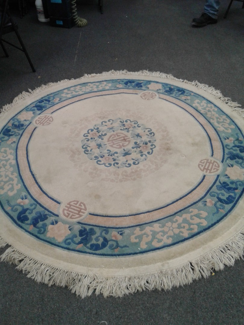 Cleaning area rugs for a client.