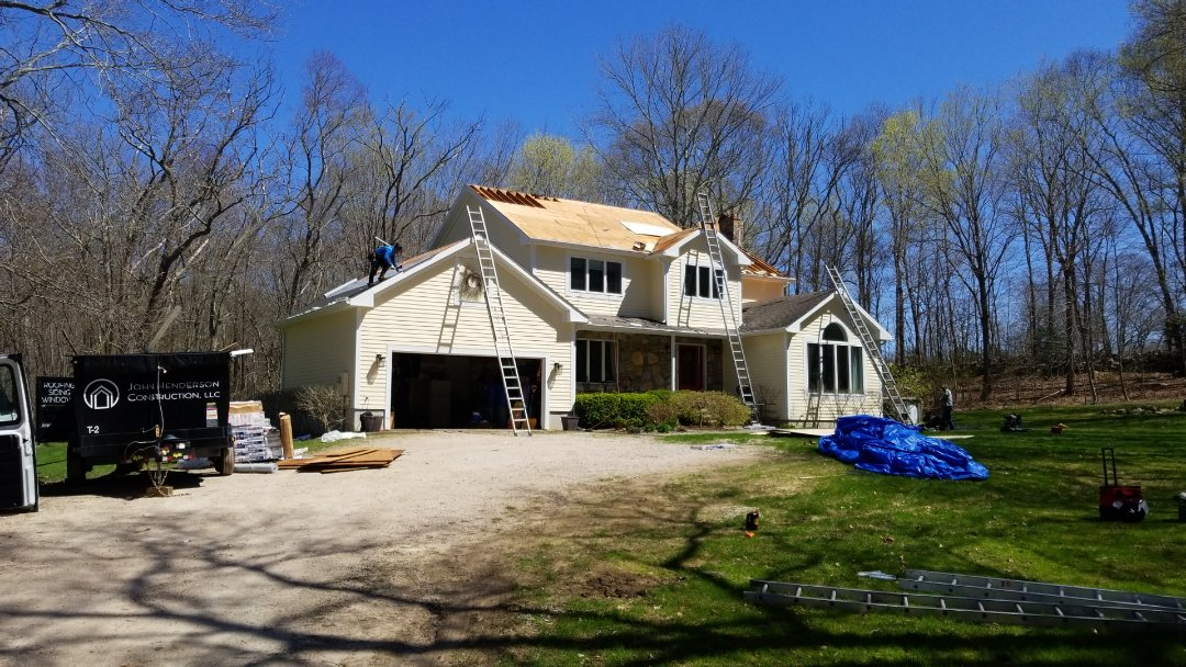 North Stonington, CT - Completely stripping roof replacing damaged plywood shingling with new timberline HD shingles.
