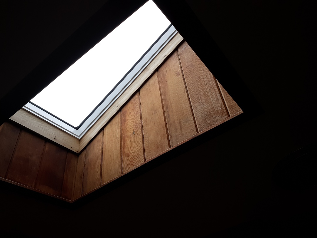 Exeter, RI - Trimmed in a new Velux skylight with cedar, tying in the existing tongue and groove over the master bathroom, after a freshly installed GAF roof system updated the topside of this home.