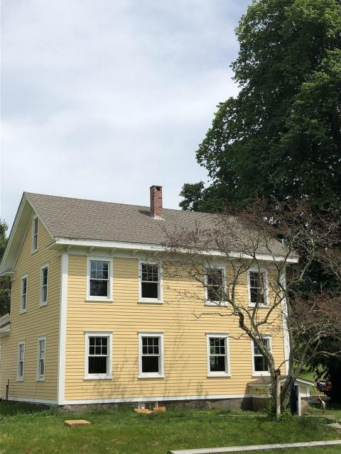 Exeter, RI - Removed old leaking roof system. Installed new sheathing. Installed new GAF Timberline lifetime shingles. Color is weathered wood. Golden Pledge Warranty