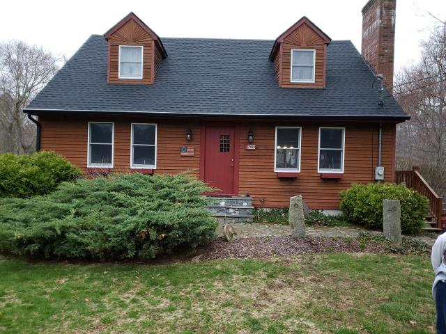 Sterling, CT - New GAF Timberline HD roof system. Charcoal roofing shingles with matching GAF Seal-A-Ridge ridge caps, over GAF Weather Watch and GAF FeltBuster. Attic exhaust through new GAF Cobra ridge vent.Installed new Black Seamless Gutters