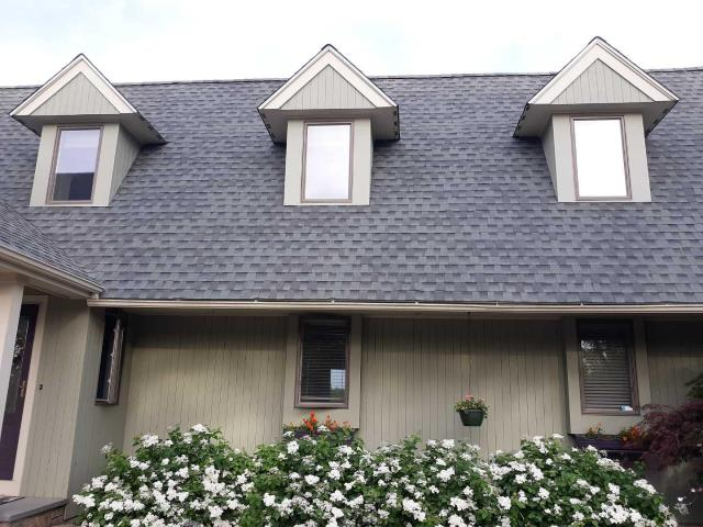 Point Judith, RI - New GAF Timberline HD roof system. Slate colored  roofing shingles with matching GAF Seal-A-Ridge ridge caps, over GAF Weather Watch and GAF FeltBuster. Attic exhaust through new GAF Cobra ridge vent.