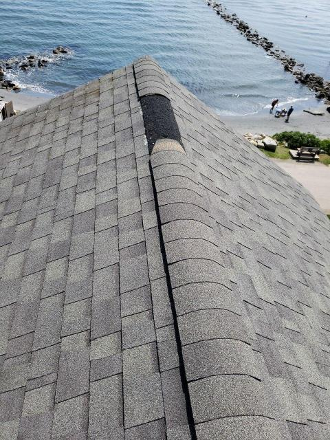 Narragansett, RI - Making a roof repair on this coastal home in Narragansett RIReplacing ridge cap shingles that have blown off due to high wind.