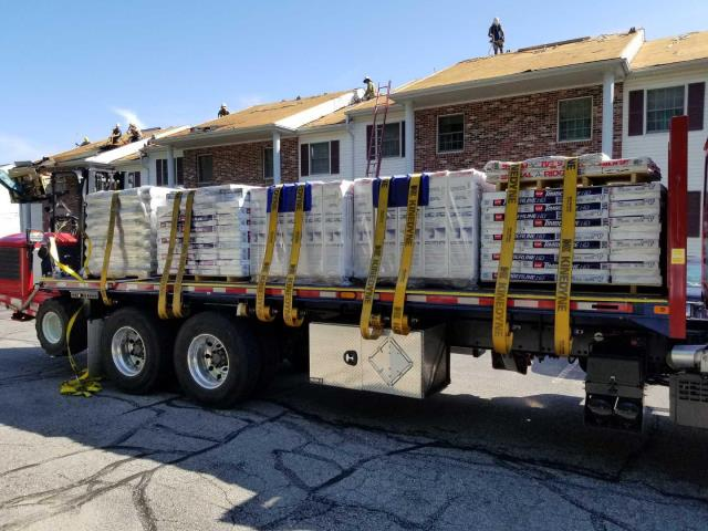 Johnston, RI - Removing two layers of old roof shingles and installing a New GAF Timberline Roof System on a condominiums In Johnston RI. Golden Pledge Warranty