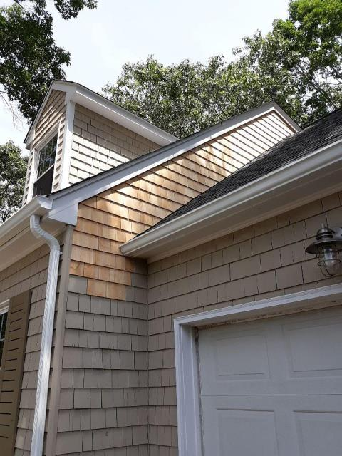 Narragansett, RI - Removed and replaced wood siding to allow new step flashings to be installed along with a new GAF Timberline HD roof system with a Golden Pledge Warranty