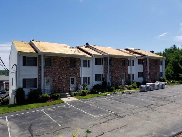 Johnston, RI - Moving along despite the heat on our Johnston RI condominium roofing project.Removing two layers of failed shingles and installing a new GAF roof system with a Golden Pledge Warranty.20 years of workmanship and 50 years on material defects!!