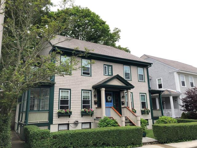 Newport, RI - Looking at removing existing slate roof and installing a new GAF Timberline roof system on a historic Newport RI home> And replacing wood gutters.
