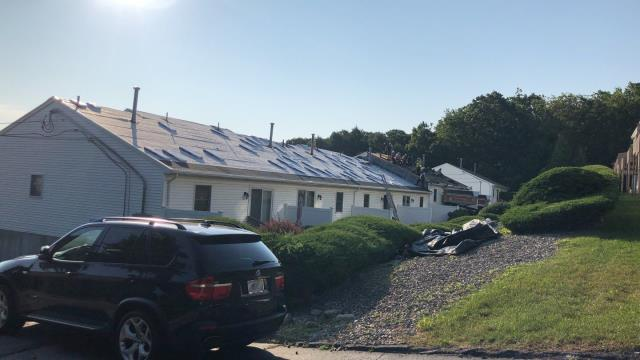 Johnston, RI - Crew is trying to beat the heat with a early start today. Removed two old layers of worn out shingles yesterday and installing new GAF Timberline HD shingles today.