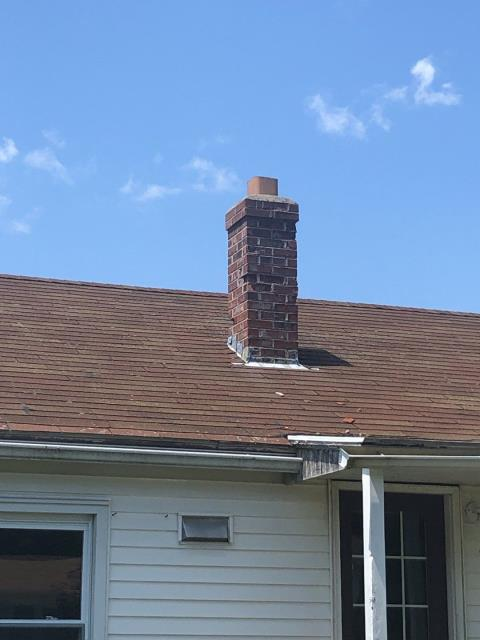 Waterford, CT - Chimney rebuild with new lead flashing to be completed before a new GAF roof system will be installed.
