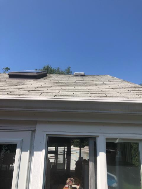 Salem, CT - Replacing porch roof shingles that are curling and cracking with new GAF roof system. New step flashings and Velux skylight flashing.