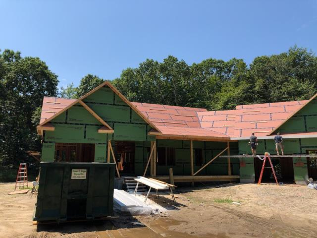 North Kingstown, RI - Measuring a new construction roof for a new GAF roof system with Standing seam metal porch roof and custom metal returns