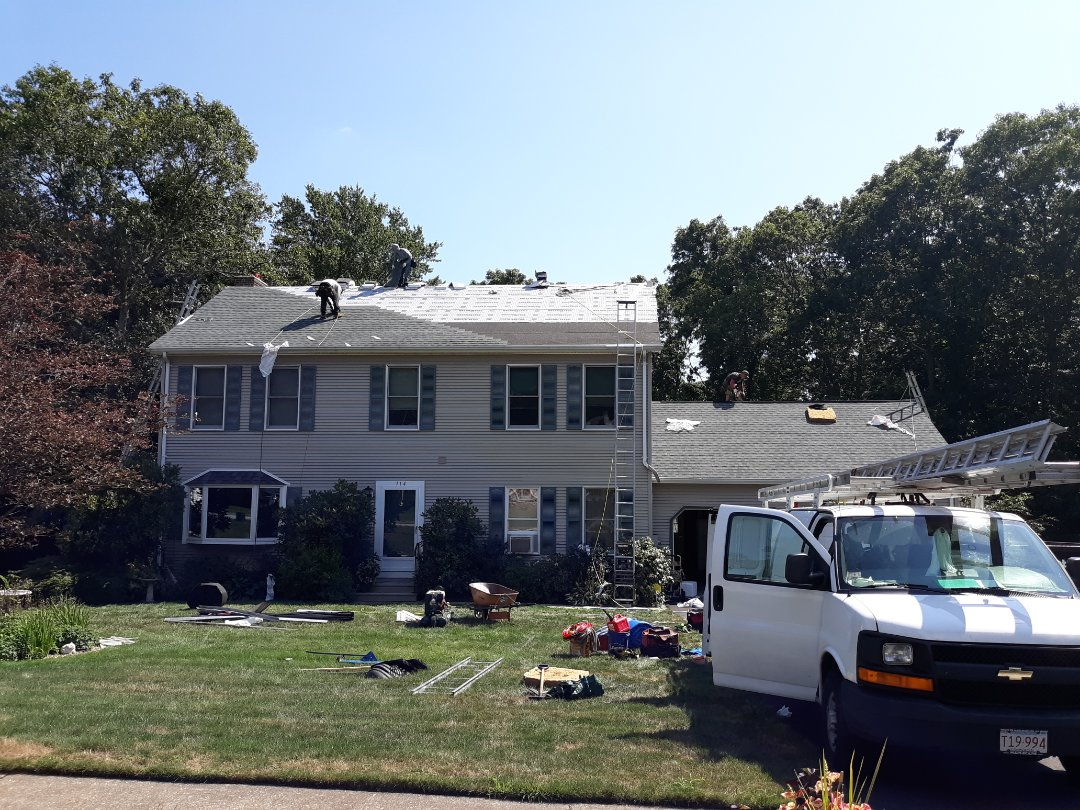 Montville, CT - Today the crew's installing a new Slate GAF Timberline HD Roofing Shingle System with matching GAF Seal-A-Ridge ridge caps over GAF Weather Watch and GAF FeltBuster synthetic underlayment and GAF Cobra ridge vent. As with all of our Connecticut roofing projects, the sheathing received code compliant seam tape.