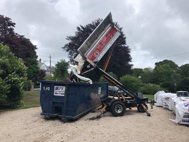 Narragansett, RI - The Equipter is making the clean up easy on a roof project in Narragansett RI