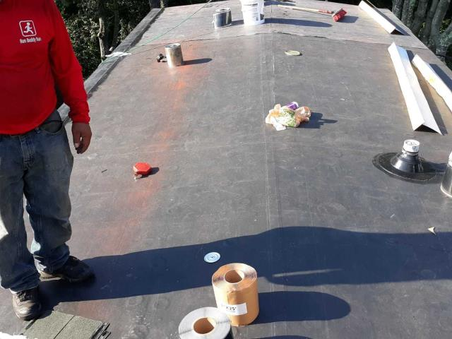 Charlestown, RI - Installing a new EPDM rubber membrane roof over new insulation board