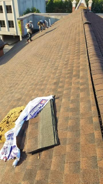 Norwich, CT - Commercial roof being completed in downtown Norwich CT. Removed multiple layers of old shingles,Installed new GAF Timberline HD roof shingles over new new plywood. color Hickory