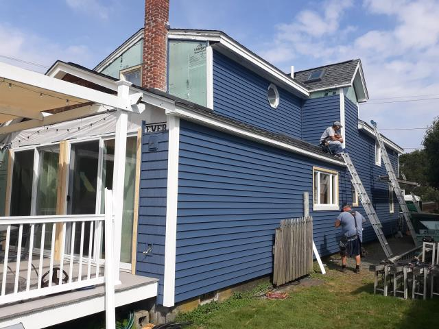 Narragansett, RI - Starting another siding project today in Narragansett RI. New foam insulation board being installed and new vinyl siding. Wrapping exterior trim with new white aluminum and also new vinyl soffits. Low maintenance siding options.