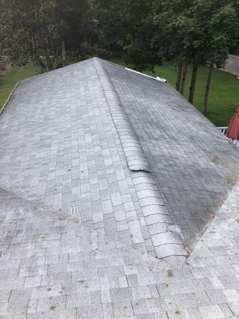 Hopkinton, RI - Inspecting a roof for possible wind damage and for leaks in Hopkinton RI.