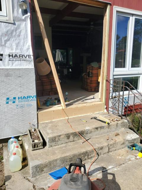 Exeter, RI - Installing new entry door. First repairing rot found under sill in old framing