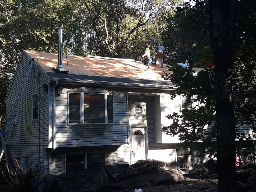 North Kingstown, RI - Today's roof is recieving a new Biscayne Blue GAF Timberline HD roof shingle system, matching GAF ridge caps and GAF Cobra ridge vent over GAF Weather Watch and GAF FeltBuster.