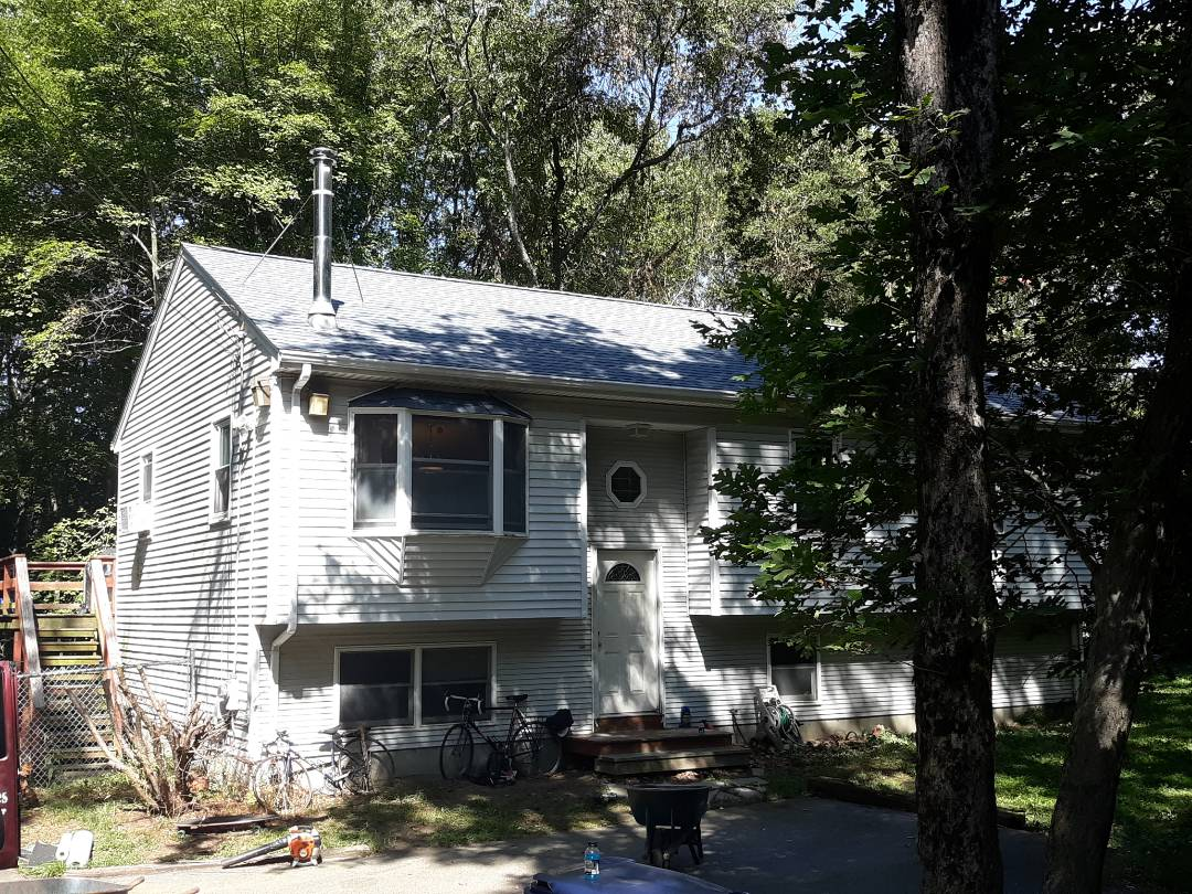 North Kingstown, RI - The crew just finished roofing this home with Biscayne Blue GAF Timberline HD roof shingles