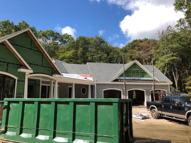 North Kingstown, RI - New Gaf Timberline HD shingles being installed. Starting to install standing seam metal roof today.