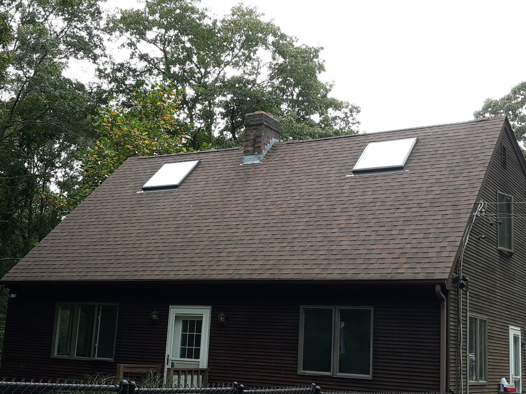 Exeter, RI - The guys just finished installing some new Velux skylights, replacing the old skylights. They wove and cut new shingles to blend in the installation