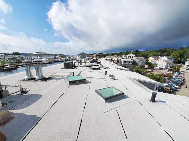 Groton, CT - Commercial flat roof repair on existing Velux skylights in Mystic CT