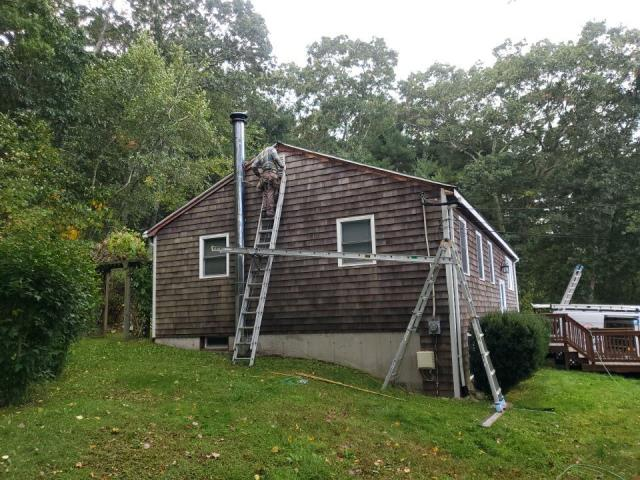 North Kingstown, RI - Removing rotten wood trim on this home in North Kingstown Ri. Installing new AZEK pvc trim on rakes and fascia. Also installing new white vinyl soffit and a new GAF Timberline HD roof will be installed next week.