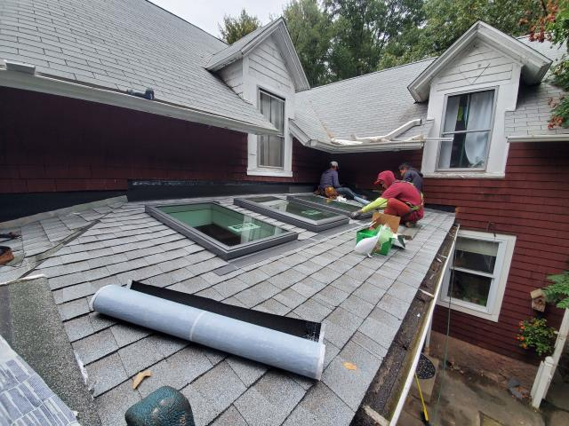 Norwich, CT - Removed old shingles and leaking skylights and replaced with new sheathing ice water full coverage and installed new VELUX skylights and new GAF shingles