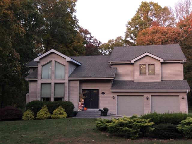 Oakdale, CT - Removed old shingles and vinyl siding on dormers and installed new flashing and a new GAF timberline HD roof shingle. Also repaired aluminum trim.