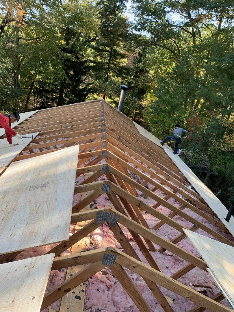 North Kingstown, RI - Roof sheathing replacement. While the old shingles were removed to replace with a new GAF Timberline HD Ultra roofing system, the crew is replacing the roof sheathing. Sometimes an older roof may lack adequate ventilation, resulting in higher moisture content, which might necessitate replacement.