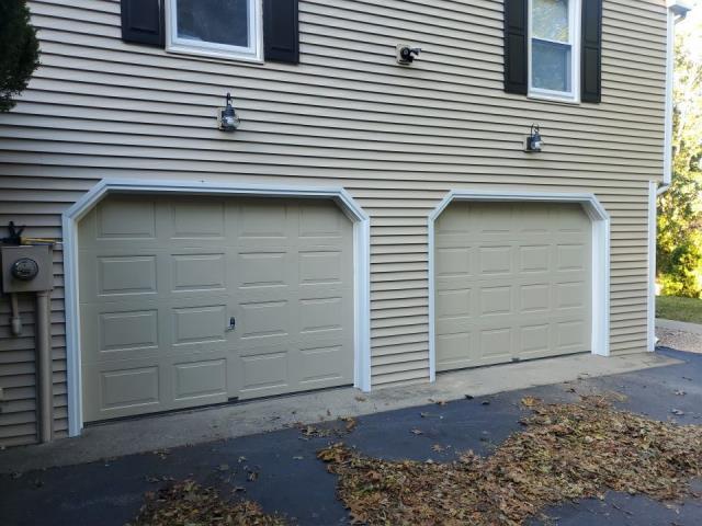 Stonington, CT - Garage doors custom painted to match new vinyl siding in Pawcatuck Ct.