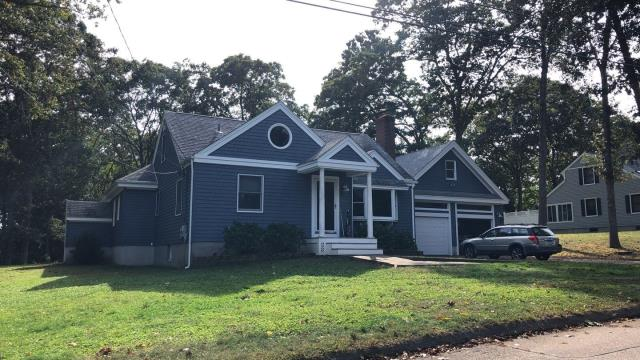 Stonington, CT - This siding project in Pawcatuck ct  is 100% complete! Removed old wood siding and installed new Vinyl Cedar impressions all new aluminum trim. Installed some new aluminum seamless gutters and gutter guards