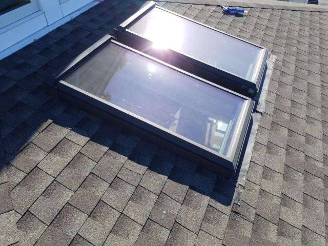 Stonington, CT - Repairing skylights on a home in Pawcatuck ct. Homeowners did not replace there skylights when they installed there new roof 1 year ago. Now we need to replace with new VELUX skylights and repair shingles around new Skylight.