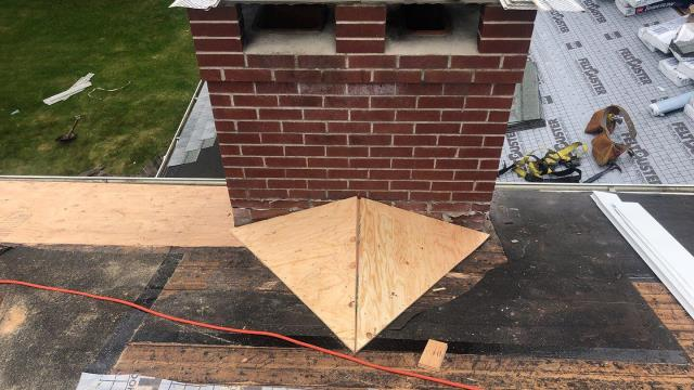 Stonington, CT - Building a cricket and installing new lead flashing on a chimney in Pawcatuck ct. This is to divert water around the chimney. And installing a new GAF roof system.