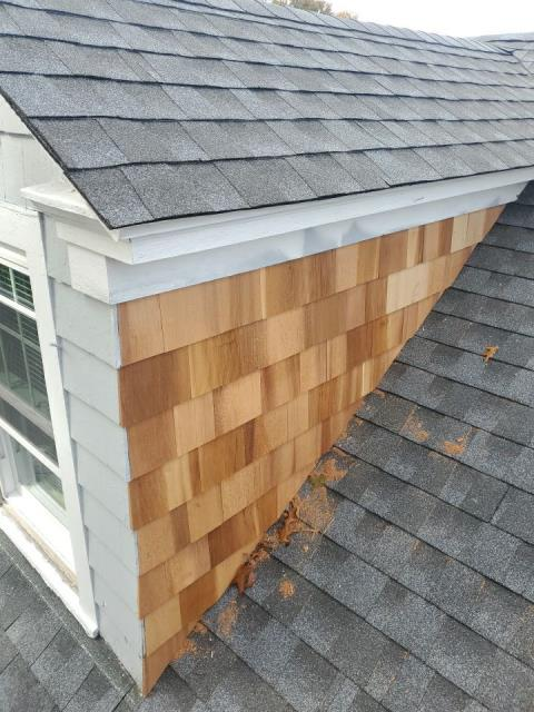Westerly, RI - Installed new red cedar siding on this dormer in westerly RI today. Installed a new GAF roof system with new step flashing to stop a leak around dormer.Golden Pledge Warranty. Color pewter grey.