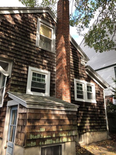 New London, CT - Measuring for new cedar siding in New London CT