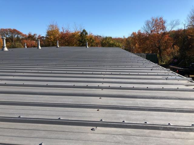 Point Judith, RI - Inspecting a metal roof in Narragansett RI. Looking at replacement costs for full EPDM rubber roof overlay verses using a 100% silicone roof coating.