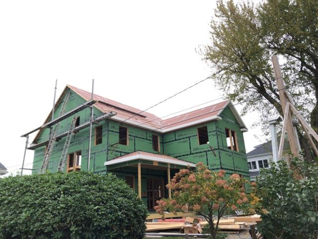 North Kingstown, RI - Measuring roof on  a new construction project in North kingstown ri. Roof will be getting a new GAF ROOF system installed!