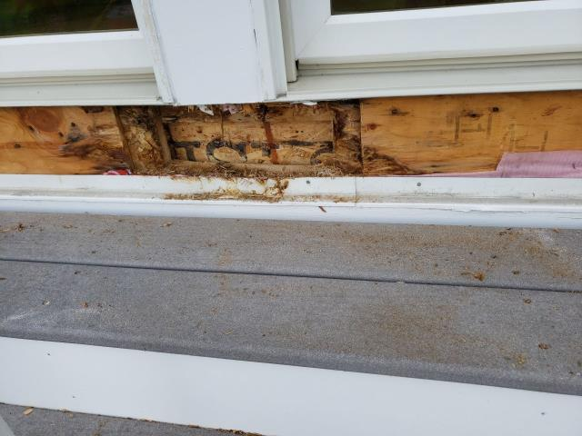North Kingstown, RI - At a Condo Complex in North Kingstown RI Repairing roofs and fixing rotten wood from leaking doors and windows.